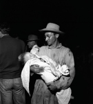 """Short Creek raid, Arizona, 1953. This man, reporter Frank Pierson wrote in his notes on the raid, """"quietly, smilingly held sleeping child until he was called into courtroom."""""""